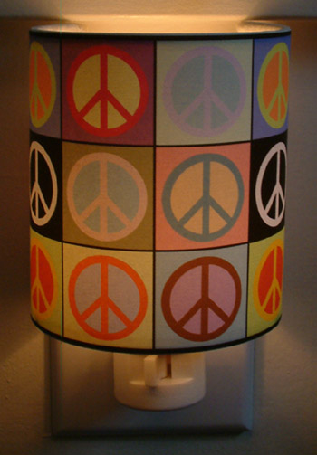 Peace nightlight peace sign nightlight peace symbol nightlight let peace light the way with these peace symbol nightlights providing beautiful soft accent lighting the plugs rotate 360 degrees to accommodate vertical aloadofball Gallery